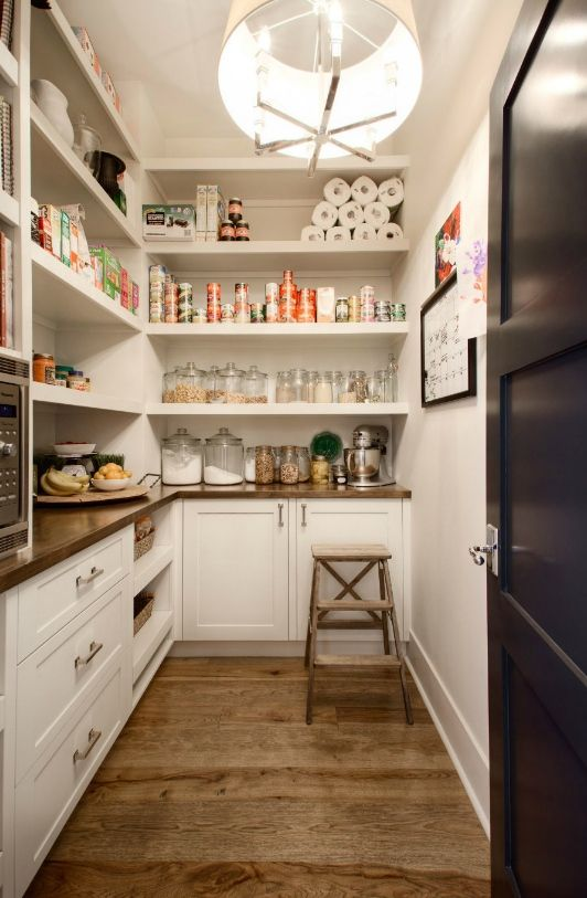 Walk in Butlers Pantry with cookbooks, drawers and gorgeous pendant light by Veranda Estate Homes.