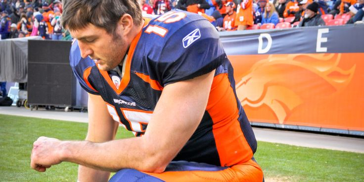 """Photo of Tim Tebow """"Tebowing"""" taken on 1-1-2012 at Sports Authority Field at Mile High (Denver Colorado). Denver Broncos vs Kansas City Chiefs Photo was taken prior to the start of the 2nd half."""