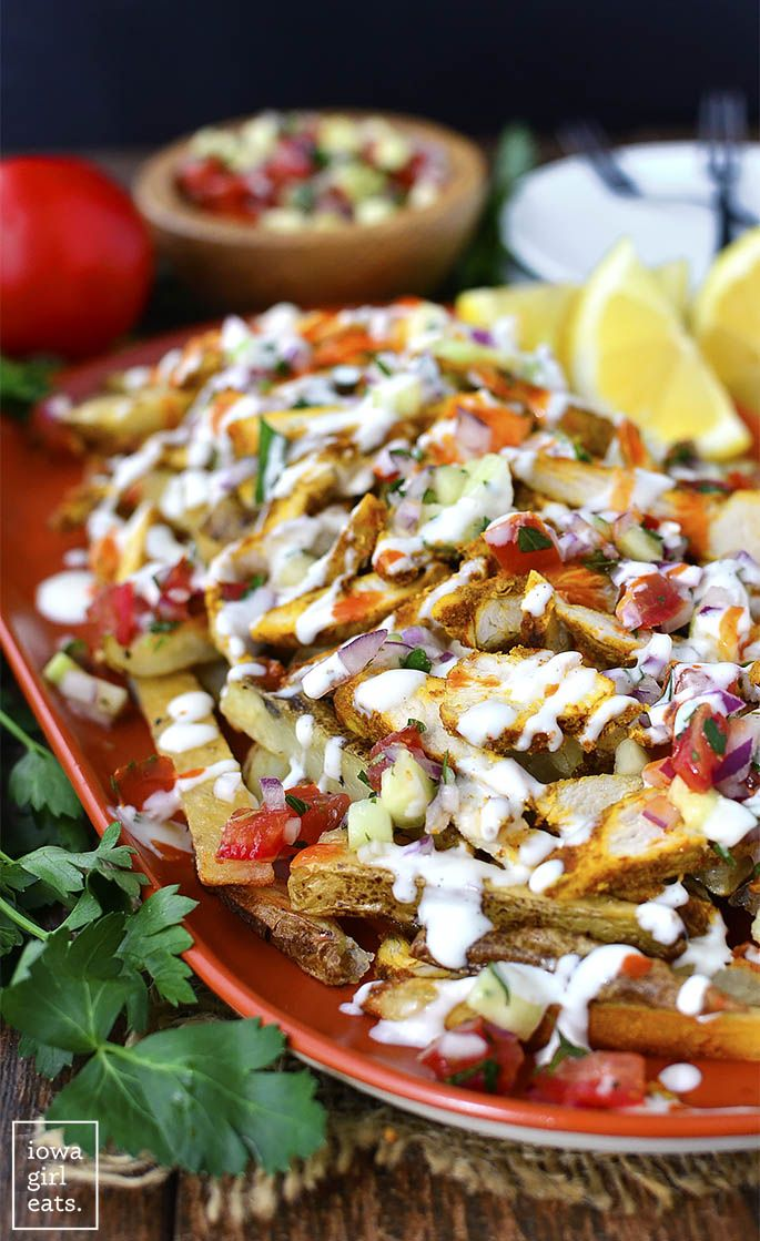 Chicken Shawarma Fries with Mediterranean Salsa and Garlic Sauce are a party on a platter.