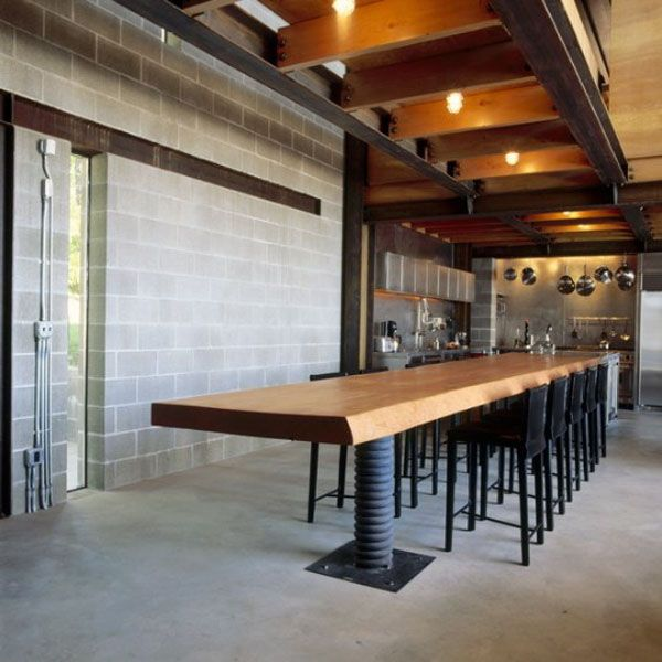 #Modern and #rustic kitchen table with screw-like leg and exposed concrete #brick walls