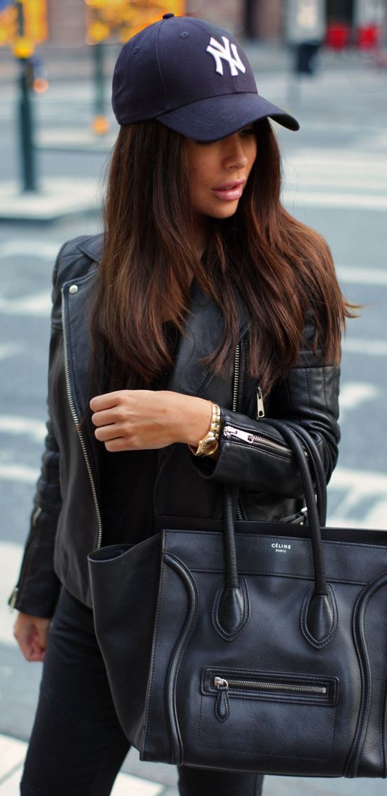 A black leather biker jacket and black skinny jeans will showcase your sartorial self.   Shop this look on Lookastic: https://lookastic.com/women/looks/biker-jacket-crew-neck-t-shirt-skinny-jeans/18122   — Black and White Cap  — Black Leather Biker Jacket  — Gold Watch  — Black Crew-neck T-shirt  — Black Leather Tote Bag  — Black Skinny Jeans