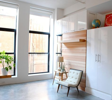 Murphy Bed Surrounded By White Cabinets