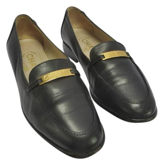 Chanel Black 35 1/2 Vintage Slip-on Loafers With Gold Plate Flats. Get the must-have flats of this season! These Chanel Black 35 1/2 Vintage Slip-on Loafers With Gold Plate Flats are a top 10 member favorite on Tradesy. Save on yours before they're sold out!