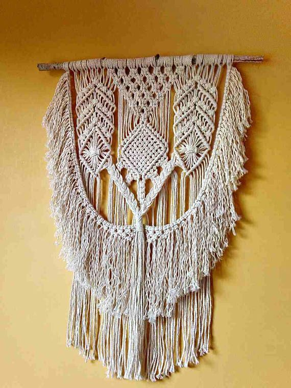 MacrameTemptation is the perfect bohemian style decor piece to hang in your living space, above your bed, or in a nursery. Add some modern softness to your room with this gorgeous macrame wall hanging! This wall hanging is made with 100% high quality twisted cotton cord and is hanging on a wood Birch.