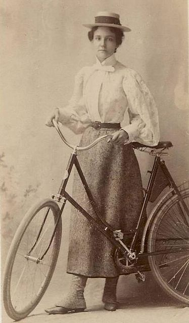 Young lady cyclist c.1900 - Note shorter skirt less width to move back into chain, and spokes. Also her gaitors which buttoned!