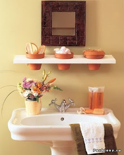 Sweet bathroom look with terra cotta pot shelf... I could totally make that!