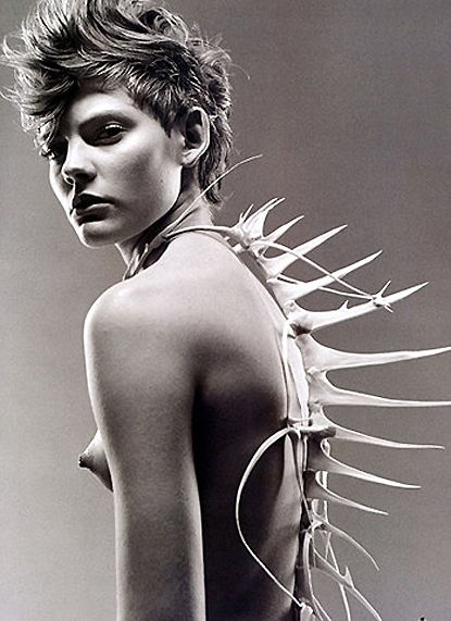 Nude with bone adornments; hybrid with a body although a stark contrast