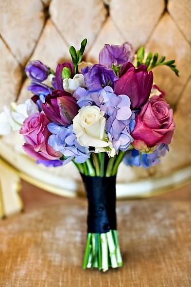 In this bouquet you will find lavender and white roses, sweet pea, hydrangea, tulips and some additional greenery.