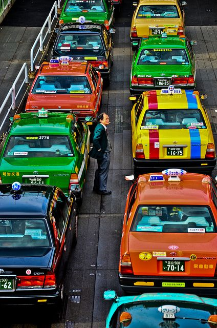 Decide what colour taxi you want to take... These taxis are in Tokyo, Japan