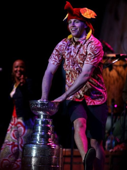 Kaner dancing with the Stanley Cup at the Jimmy Buffet concert