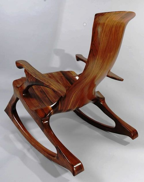 Custom Walnut Rocker by Kevin DesPlanques. Kevin sculpts unique furniture using the stack lamination process. He creates custom chairs that fit so precisely that they feel as if they have been molded exactly to your body.