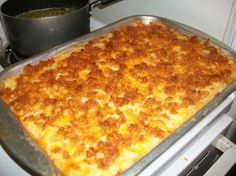 2 lbs hash browns  1/2 cup butter  2 (10 3/4 ounce) cans condensed cream of chicken soup  1 pint sour cream  1/2 teaspoon salt  3/4 cup onion, chopped  1 tablespoon butter  2 cups longhorn cheese, grated, firmly packed  1 1/2 cups corn flakes, crushed  4 tablespoons butter, melted    Read more at: http://www.food.com/recipe/funeral-potatoes-55389?oc=linkback