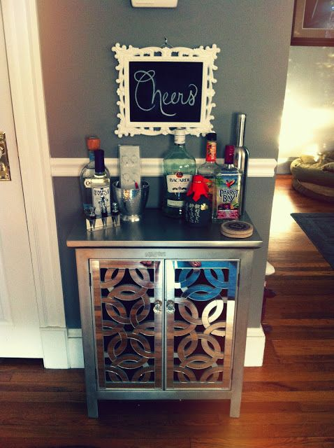 Love the cheers chalk board. Great small bar idea...I think tis is beautiful and so practical!