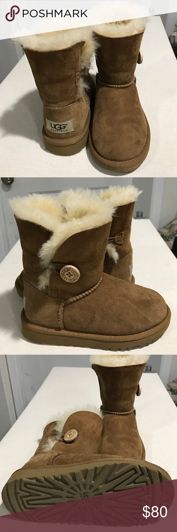 Children's Ugg boots with button sides Super cute tan Ugg boots for your little one! Gently worn (maybe twice?).  One button on the outside of the ankle. So warm and fuzzy and perfect for any little fashionista!!!! Comes from a home with dogs so may have tiny hairs that traveled through the air.  Does not come with box. Firm on price. Thank you :) UGG Shoes Boots