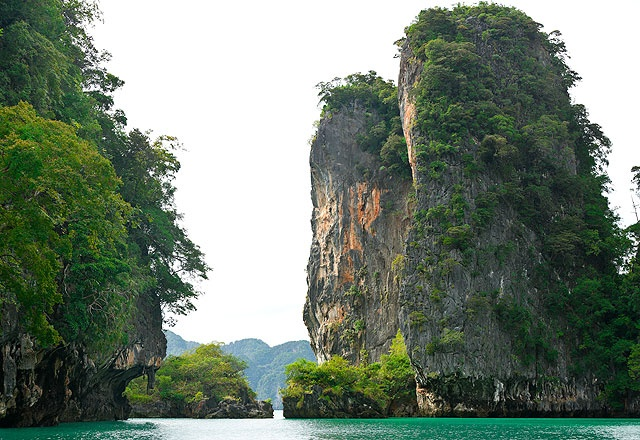 Limestone cliffs dominate the landscape of Ao Phang-Nga. One of the bay's islands \u2013 Ko Tapu \u2013 was made famous by the 1974 James Bond film The Man with the Golden Gun<\/i>.