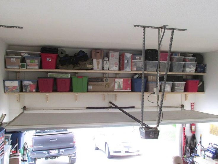 Elegant Storage Shelves Above Garage Door | Keeps The Mess Concealed From Street  View
