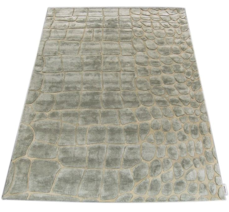 calvin klein is innovative collection of luxury handmade rugs featuring a soft very dense and luminescent viscose silk pile with deep canyons of