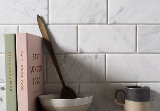 Our Bianco Carrara C Honed Marble metro tiles make a gorgeous splashback