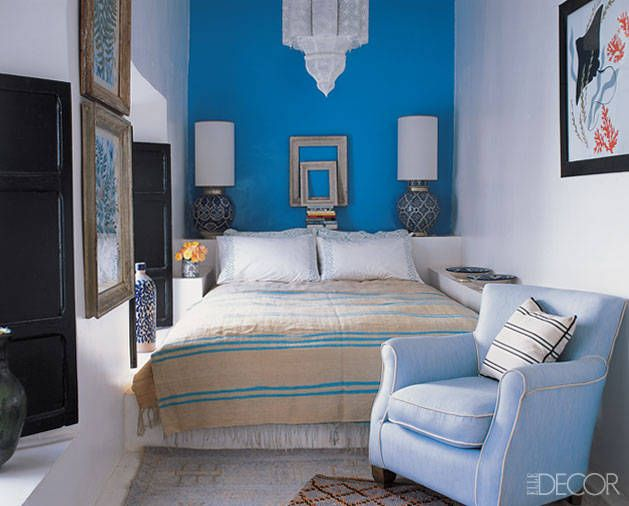 guest bedroom that looks right at home in their 18th-century Marrakech house, situated inside a mosque complex. The lamps have Fez-pottery b...