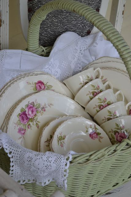 Vintage tea cups and plates displayed in a basket - frenchblueandpeachypink