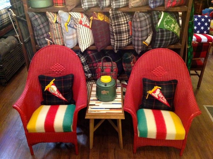 Recover chair cushions with an old Hudson Bay blanket, like this wicker pair from Brimfield, Chicago.