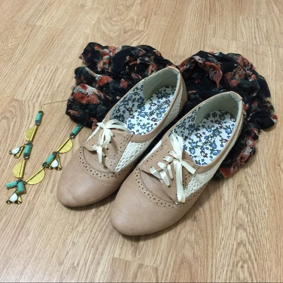 """Crochet Embellished Oxfords Tan and cream oxford style flats with crochet embellishment and ribbon ties. Worn 2-3 times. The only wear is on the bottom of shoe and inside of heel. No visible wear while wearing. True to size """"Tiffany Oxford"""" from Maurices. Original box included. Maurices Shoes Flats & Loafers"""