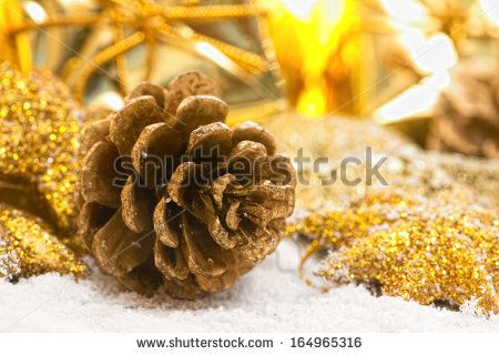 golden pinecone with christmas decorations by Donatella Tandelli, via ShutterStock