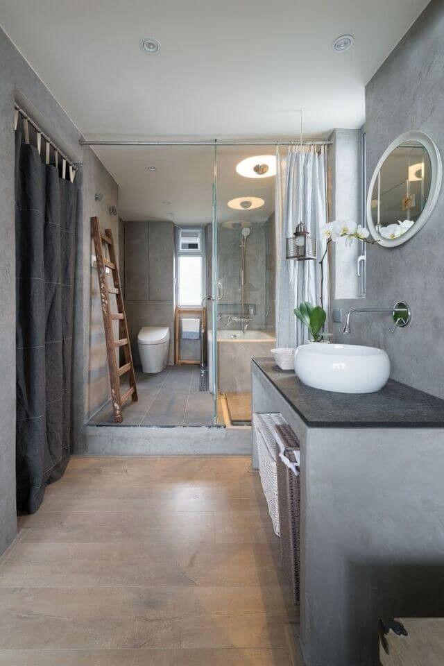 Dies ist ein rustikal aussehende Bad mit grauen Wänden und Zähler-Basis. Der Zähler nach oben selbst besteht aus dunkler Marmor.