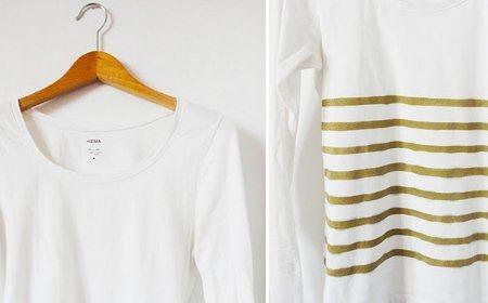 Si vas a rociar spray sobre la camiseta te recomiendo  1-Usar un cartón o similar dentro de la camiseta para evitar que se manche con la pintura al reverso de la camiseta.  2-Usar papel adesivo para la plantilla, lo pegas en la camiseta y te evitas sostener la cartulina y puedes rociar de mejor manera el spray.  3-Rocíar el spray a un mínimo de 30cm de distancia de la camiseta, sino se te arruinará.