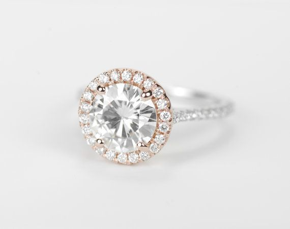 Sparkling Color Enhanced Forever Brilliant Moissanite set in a very beautiful high - quality diamond setting. Two - tone with rose gold halo...