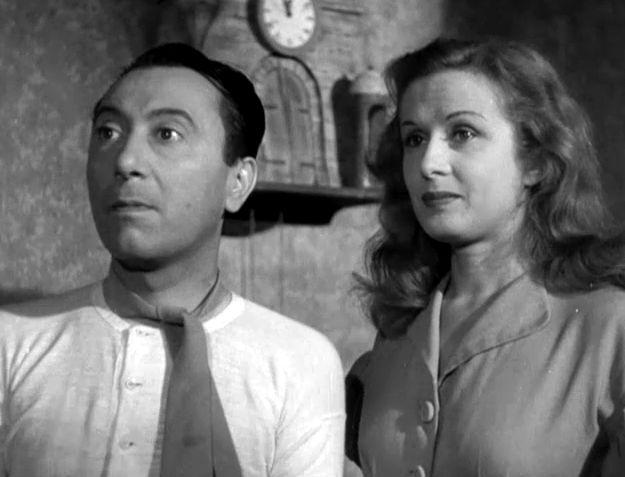 """Macario (Erminio Macario) and Vera Carmi in Carlo Borghesio's """"Come persi la guerra"""" (English title: """"How I Lost the War"""", 1948)."""