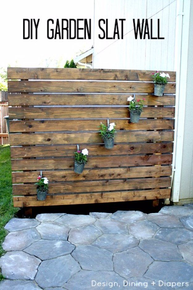 DIY Porch and Patio Ideas - DIY Garden Slat Wall for your Patio - Decor Projects and Furniture Tutorials You Can Build for the Outdoors -Swings, Bench, Cushions, Chairs, Daybeds and Pallet Signs  http://diyjoy.com/diy-porch-patio-decor-ideas
