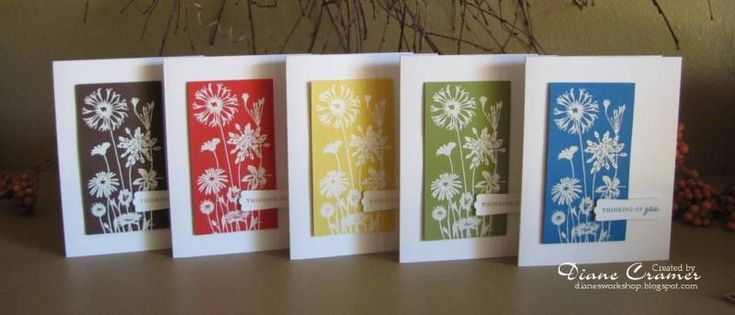 handmade notecard set ... clean and simple .... meadow flowers embossed in white on panels in pretty colors ... lovely!!