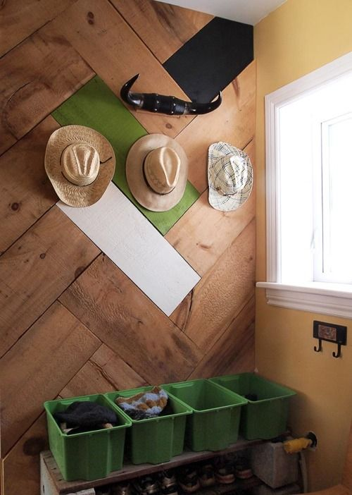 This DIY herringbone wall project is a great way to incorporate salvaged wood into your home for a subtle yet stylish twist on wooden paneling. It looks great with natural light - try it in your kitchen or mud room!