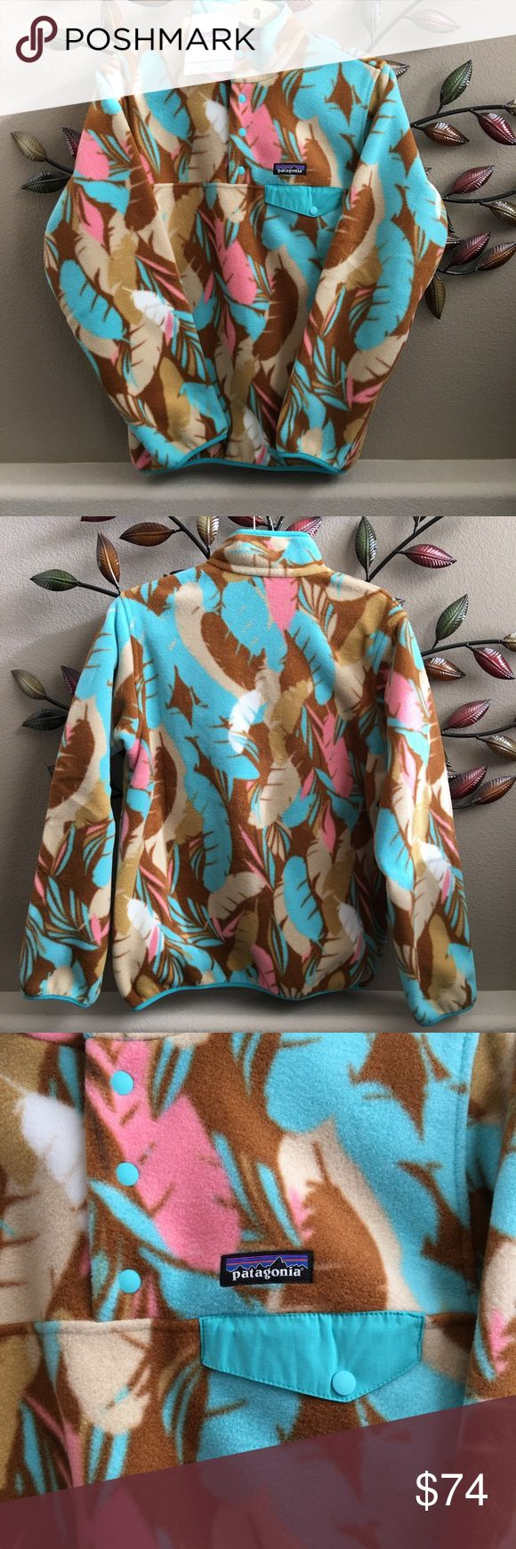 Darling NWT Patagonia Synchilla Snap T Pullover. Brand-new with tags darling feather print Patagonia women's size medium Snap T Pullover. Makes a great gift! Patagonia Sweaters