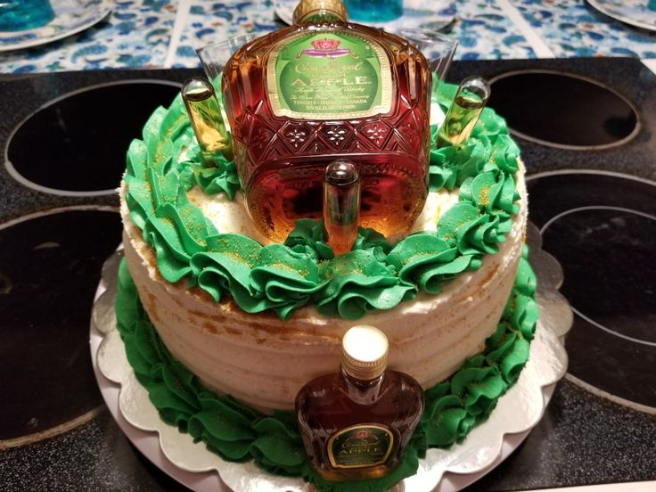 Apple crown royal cake .......vanilla cake with buttercream topped with apple crown decor!!! Recipe for the cake I used Swans down 1234 butter cake with a basic buttercream recipe from google that I added a tablespoon apple crown to. Decirated with apple crown .