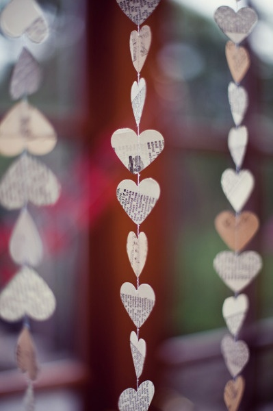 Another affordable paper option for wedding decor.  Use vintage books or newspaper to cut out hearts.  String them and hang.