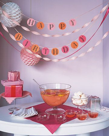 Letter-perfect party decor is easy with a garland made using our clip-art alphabet. Here, a birthday greeting in warm tones hangs above a serving table done up in similar shades of pink and orange. To make this garland, download the alphabet from our website and create your own. No matter the occasion, you won't be at a loss for words.