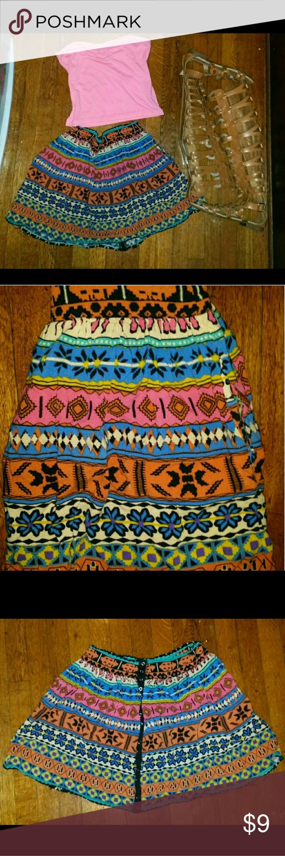 Tribal print skirt ?? This tribal print skirt buttons up in the back (shown in picture) it is my favorite skirt which I can no longer fit ?? had for so many years... there's a small rip on the end of one side of the skirt but it is very unnoticeable! Otherwise this is a very lightweight skirt and is perfect for the up coming summer season!! Message me if you have any questions I reply back fast and I am open to deals. Enjoy my closet ?? Forever 21 Skirts Circle & Skater