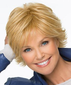 Special by Christie Brinkley - This short layered hairstyle features feathered bangs, a soft flip and a natural fit wig cap.  These features combined with heat friendly synthetic hair create a ready to wear no hassle wig.  Give it a gentle shake and you are ready to go!