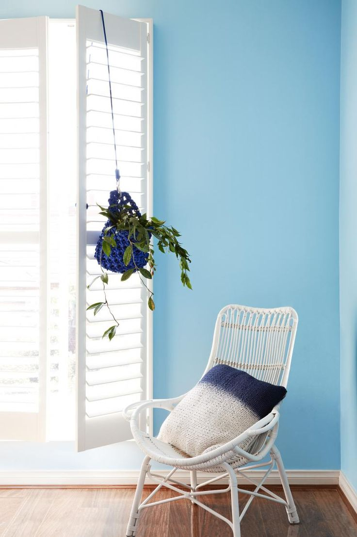 IOT0414_FTCOL_08-copy blue room white shutters wicker chair  beach