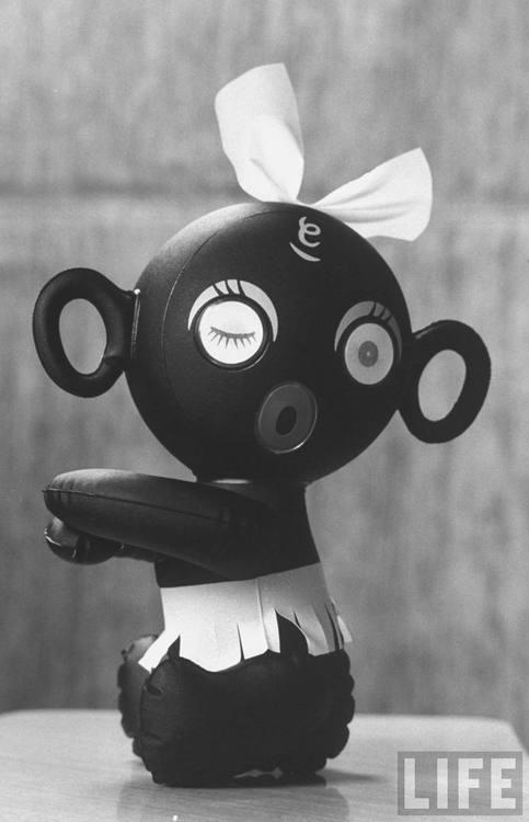 Embraceable 'Dakkochan' doll  Photographer: John Dominis  Tokyo, Japan, August 1960.  © Time Inc.