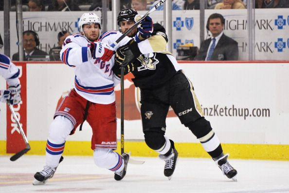 Matt Niskanen #2 of the Pittsburgh Penguins checks Derick Brassard #16 of the New York Rangers to hold him up at the blueline during the third period in Game Two of the Second Round of the 2014 NHL Stanley Cup Playoffs on May 4, 2014 at Consol Energy Center in Pittsburgh, Pennsylvania. Pittsburgh defeated New York 3-0.