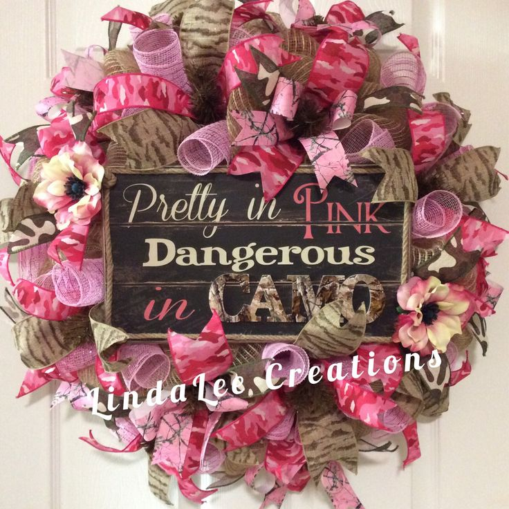 """FOR SALE """"Pretty in Pink""""($106) Love the camo...every girl should have this! This wreath is 28""""x28""""x7""""deep, burlap deco mesh, light brown wire frame, pink deco mesh curls, wood signage, silk flowers, 2.5"""" pink camo ribbon, 2.5"""" tan/gold animal print ribbon, 1.5"""" pink camo ribbon, 1.5"""" burlap camo ribbon, 1.5"""" light pink camo grosgrain ribbon. If interested, please message me for details. Thank you!"""