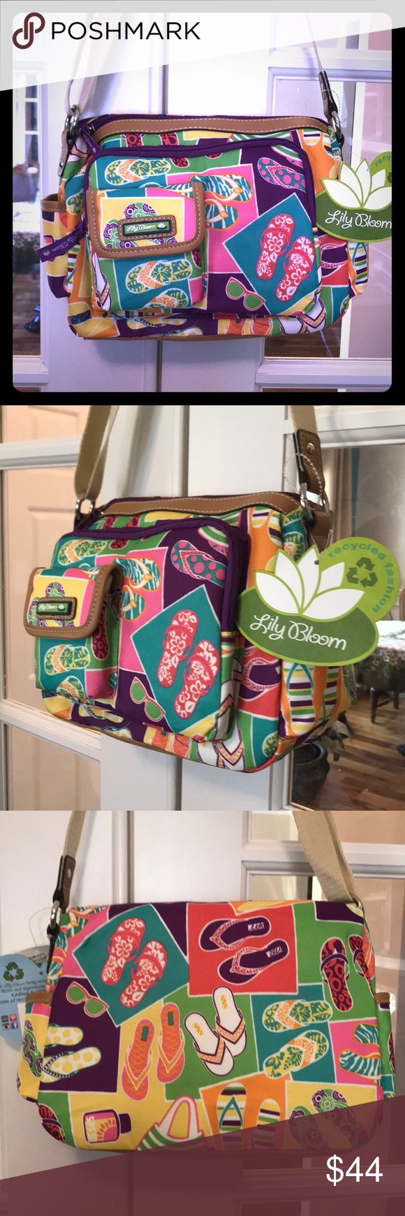 """🆕 Lily Bloom Libby """"Flip Flop"""" Hobo This colorful LilyBloom Flip Flop Bag has many pockets!  All compartments are lined with Lily Bloom fabric and zippers are the Lily Bloom tag. The main compartment opens wide & has a large front zippered pocket on it.  There is also another smaller pocket that snaps closed in it!  Each side of the bag has a slip pocket as well.  The bag is made of Lily Bloom signature fabric KARMA BLOOM made of recycled plastic bottles!   Roughly 12""""L x 8.5""""H x 4""""W.   💞…"""