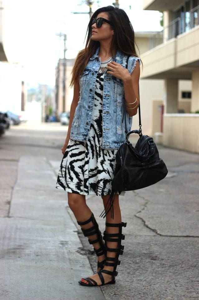 Fashion blogger Sazan in our new tiger print dress! Love her boho look with the gladiator sandals!
