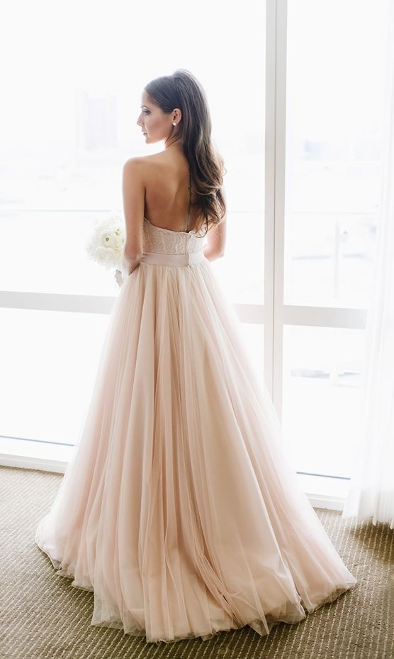 Stunning strapless blush pleated tulle skirt wedding dress; Featured Photographer: Natalie Franke Photography