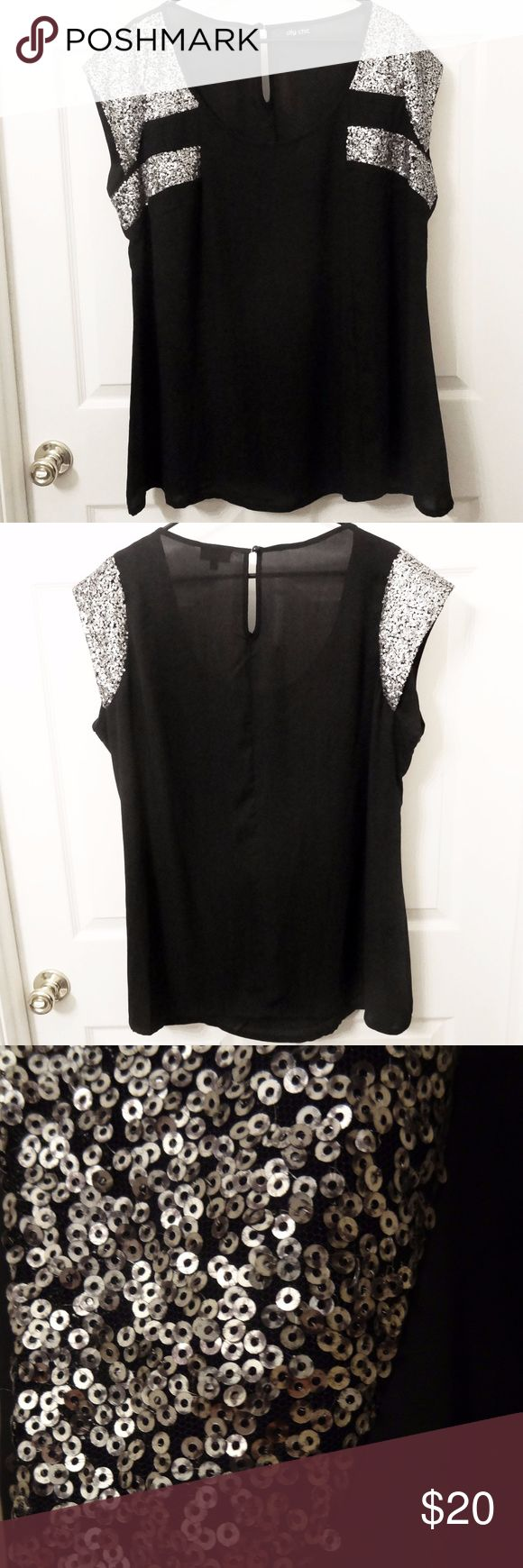 Black and Silver Short Sleeve Blouse Gorgeous short sleeve black and metallic silver sequin sheer blouse. This is a great sparkly top and is perfect for work or a night out. It's in great condition and has only been worn a few times. Tops Blouses