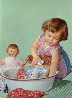 my dear dolly vintage picture girl in apron washing doll clothes
