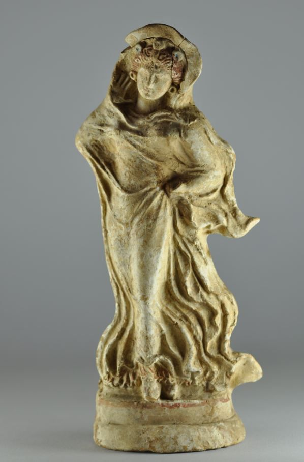 Tanagra figurine, 3rd century B.C. Tanagra figurine terracotta statuette of draped female with red hairs and earrings, 25 cm high. Private collection